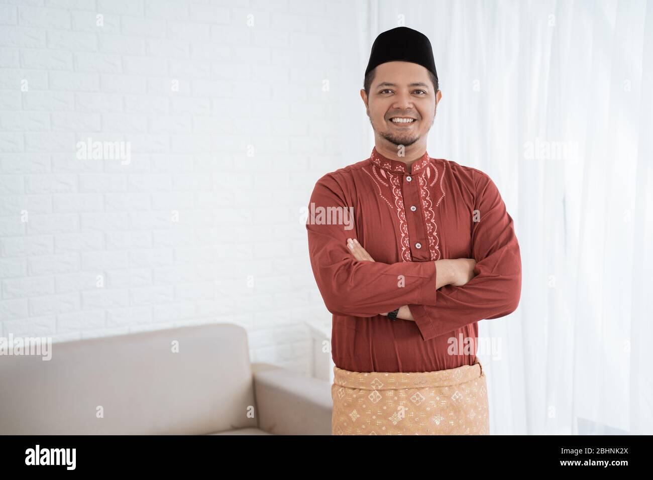 Asian Man Smile Standing With Crossed Hands Wearing Traditional Malay Clothes Stock Photo Alamy