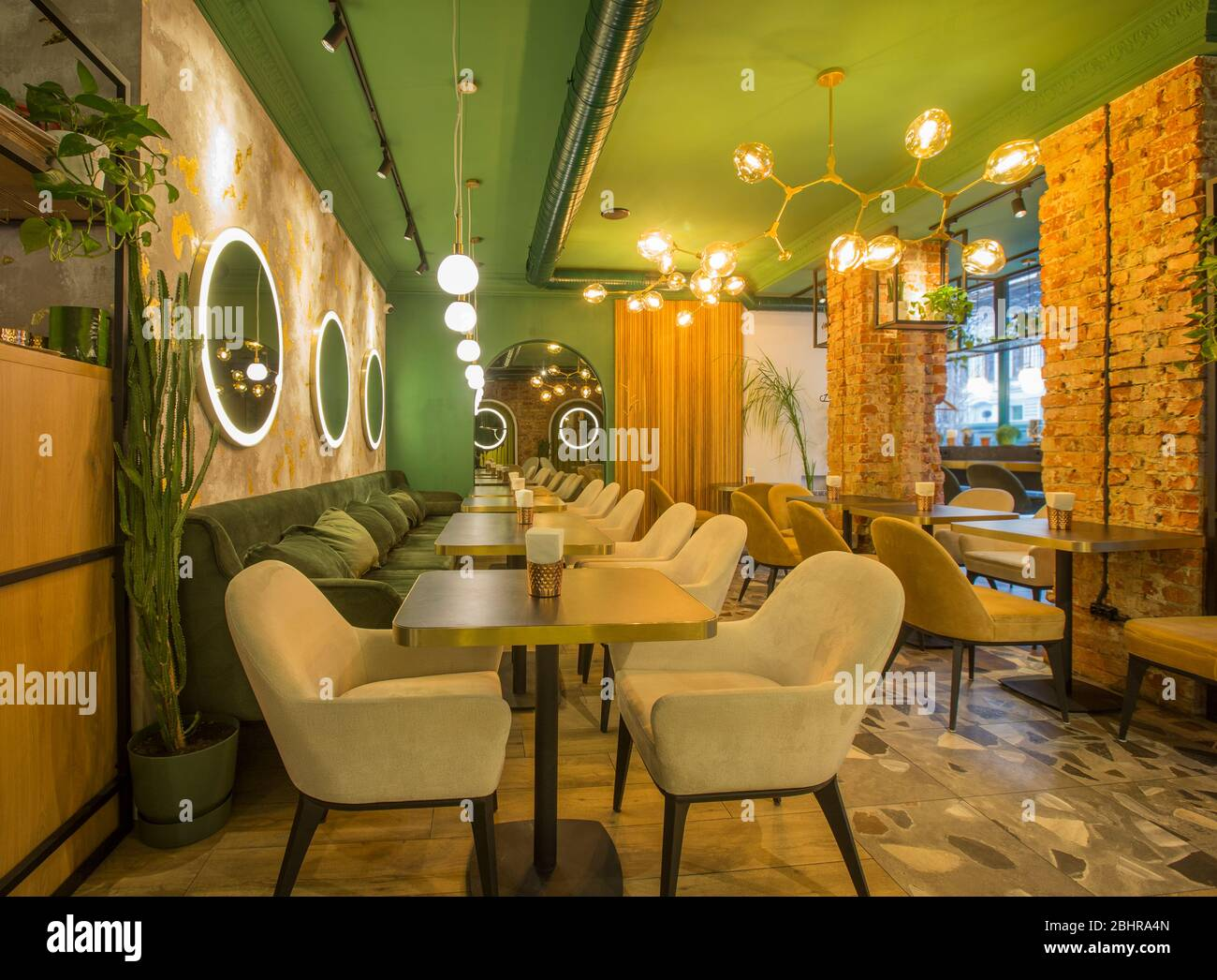 Roomy Hall In Restaurant Or Cafe With Wooden Furniture And Walls Of Red Bricks Stock Photo Alamy