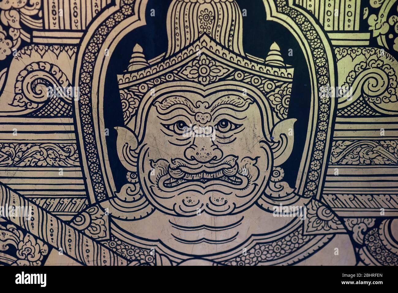 Golden guardian at the entrance door of the Phra Maha Mondop, Wat Trimitr, Bangkok, Thailand. Stock Photo