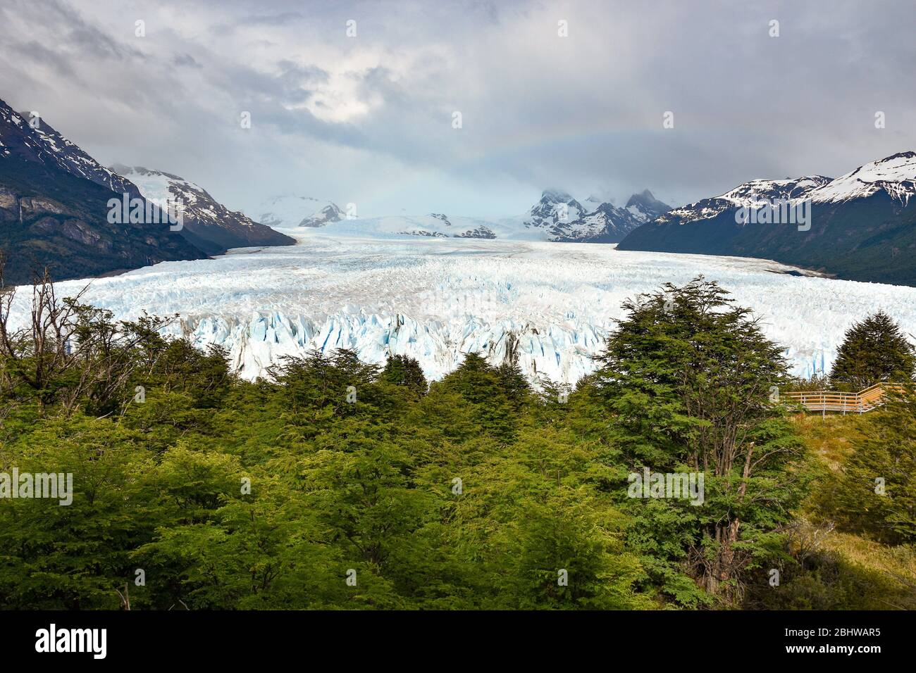 landscape with Perito Moreno glacier, andes mountains, forest and rainbow, Patagonia, Argentina Stock Photo