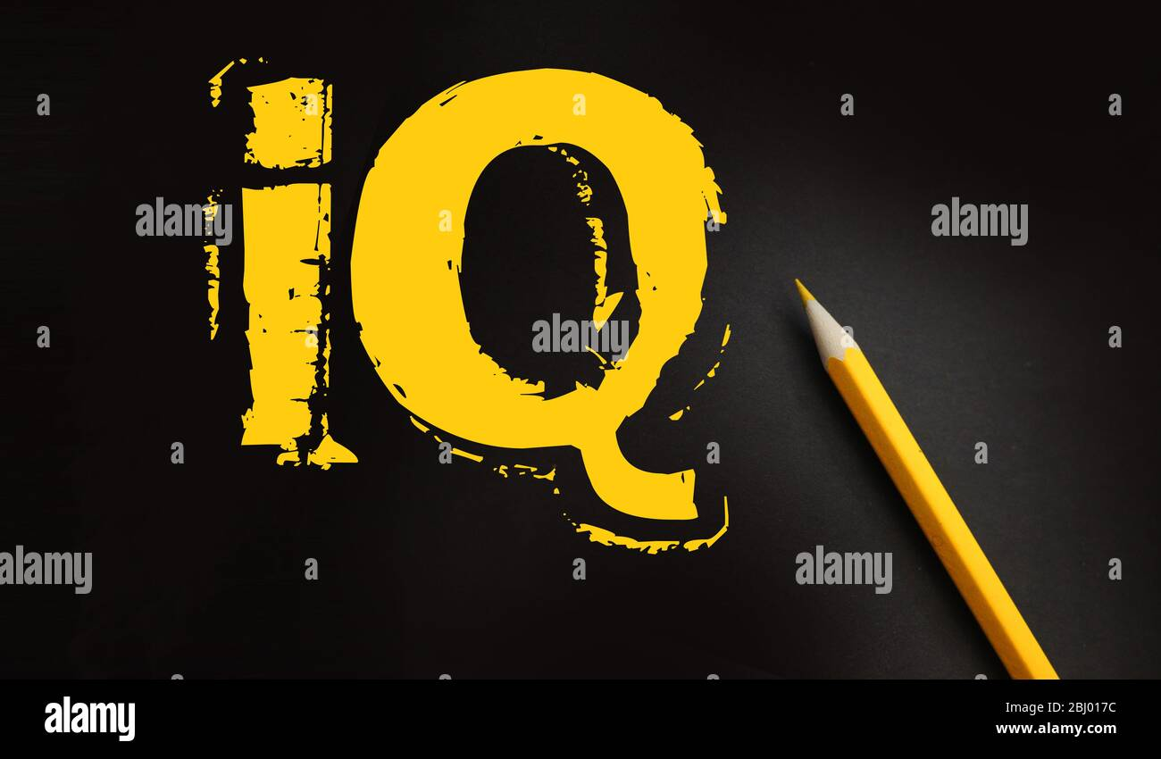 IQ text yellow on black and pencil besides. Intellectual test intelligence quotient education concept Stock Photo