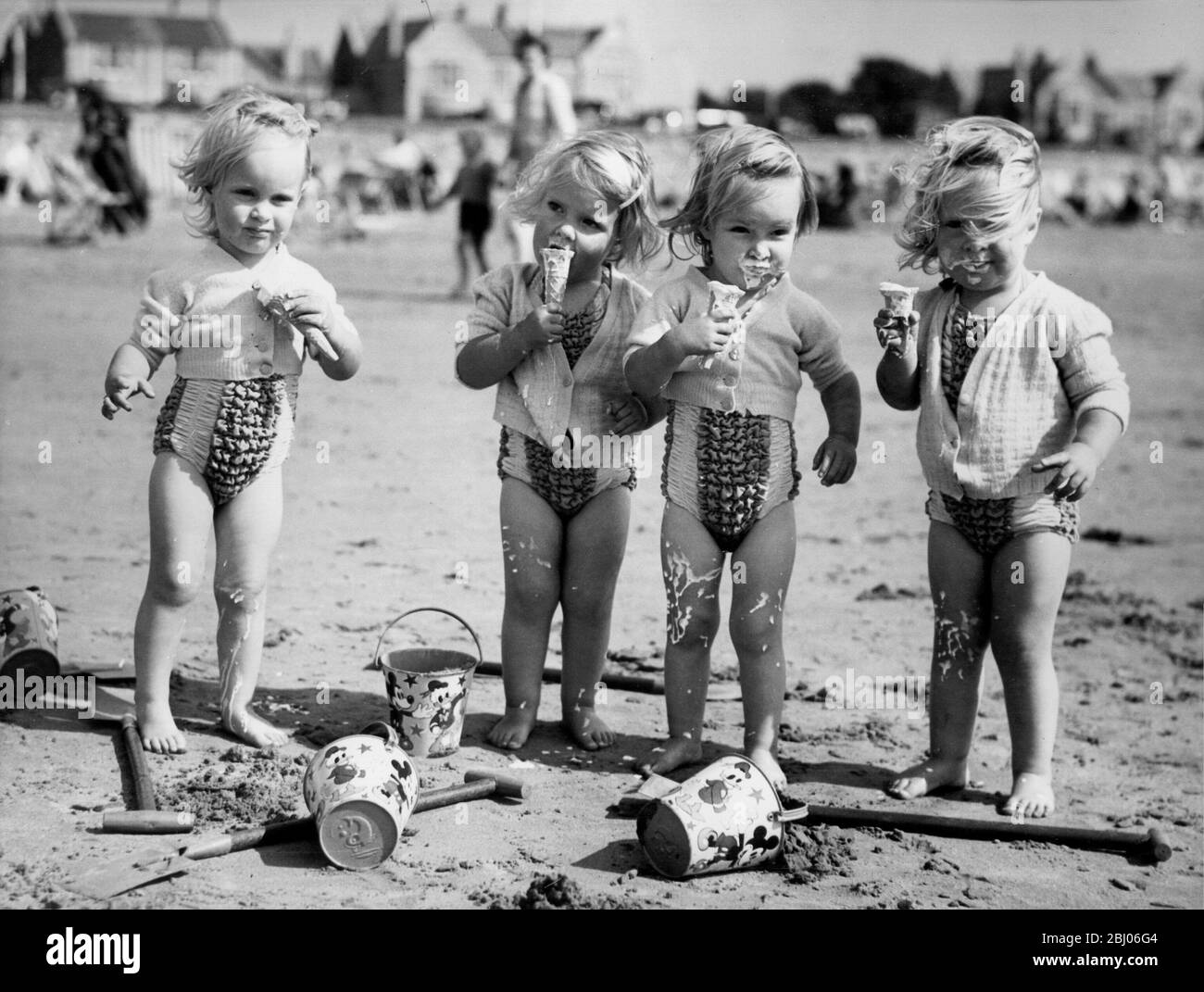 the-goods-quads-on-the-beach-at-weston-super-mare-with-ice-cream-cornets-from-left-to-right-bridget-jennifer-elizabeth-and-frances-the-quads-are-two-years-old-6th-august-1950-2BJ06G4.jpg