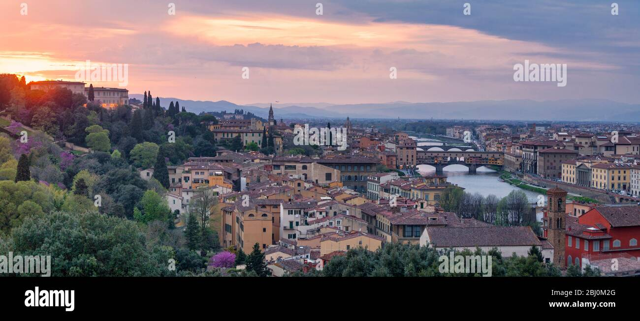 Panoramic view of Florence at sunset with in the background, the Basilica di Santo Spirito (English: Basilica of the Holy Spirit) and its spire, the C Stock Photo