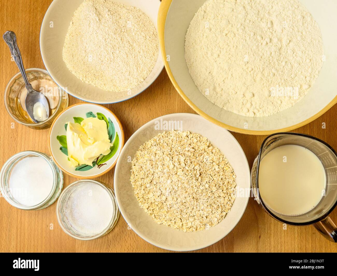 Ingredients for making oat bread on a kitchen table Stock Photo