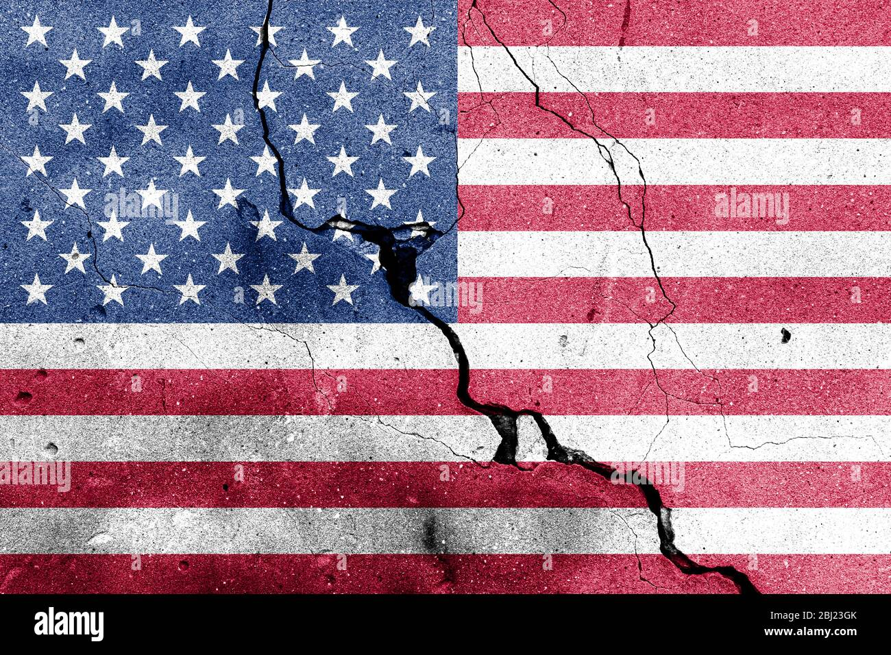 USA flag on cracked concrete wall. The concept of crisis, default, economic collapse, pandemic, conflict, terrorism or other problems in the country. Stock Photo