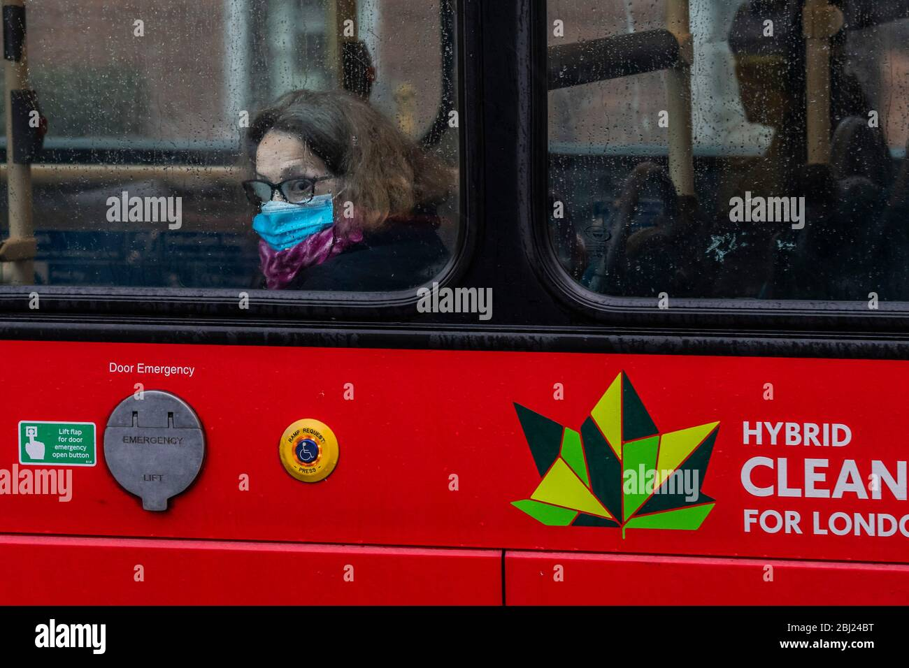 London, UK. 28th Apr, 2020. Bus travel is free and provides a brief respite from the weather - The first heavy rain doesn't stop, but greatly reduces, outdoor activity around Clapham Common. The 'lockdown' continues for the Coronavirus (Covid 19) outbreak in London. Credit: Guy Bell/Alamy Live News Stock Photo