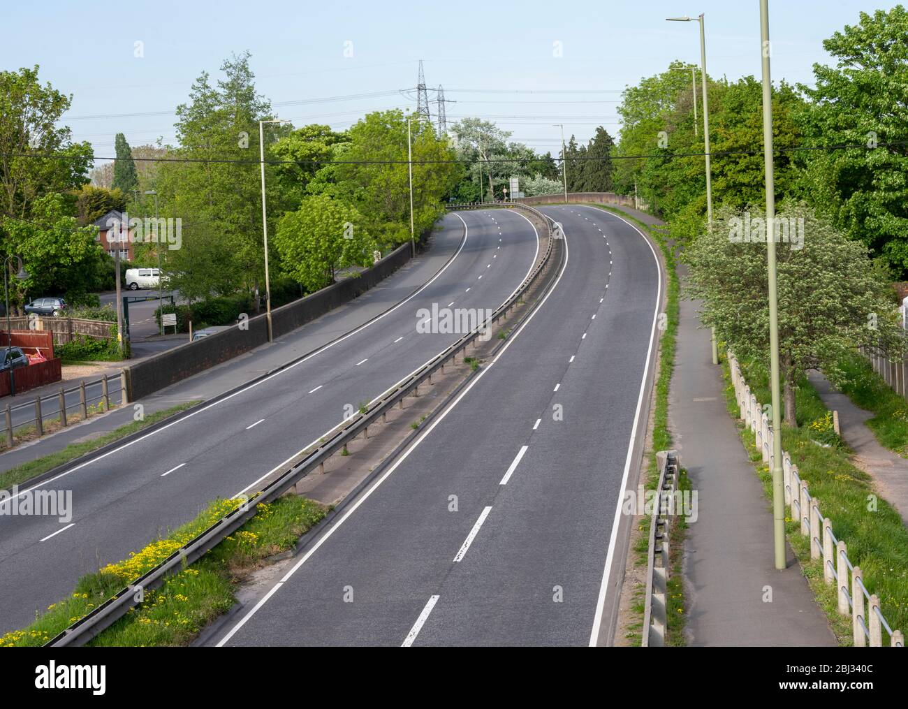 """an empty main road (A35 Totton Bypass) due to the """"Stay at home"""" coronavirus message - April 2020 Stock Photo"""