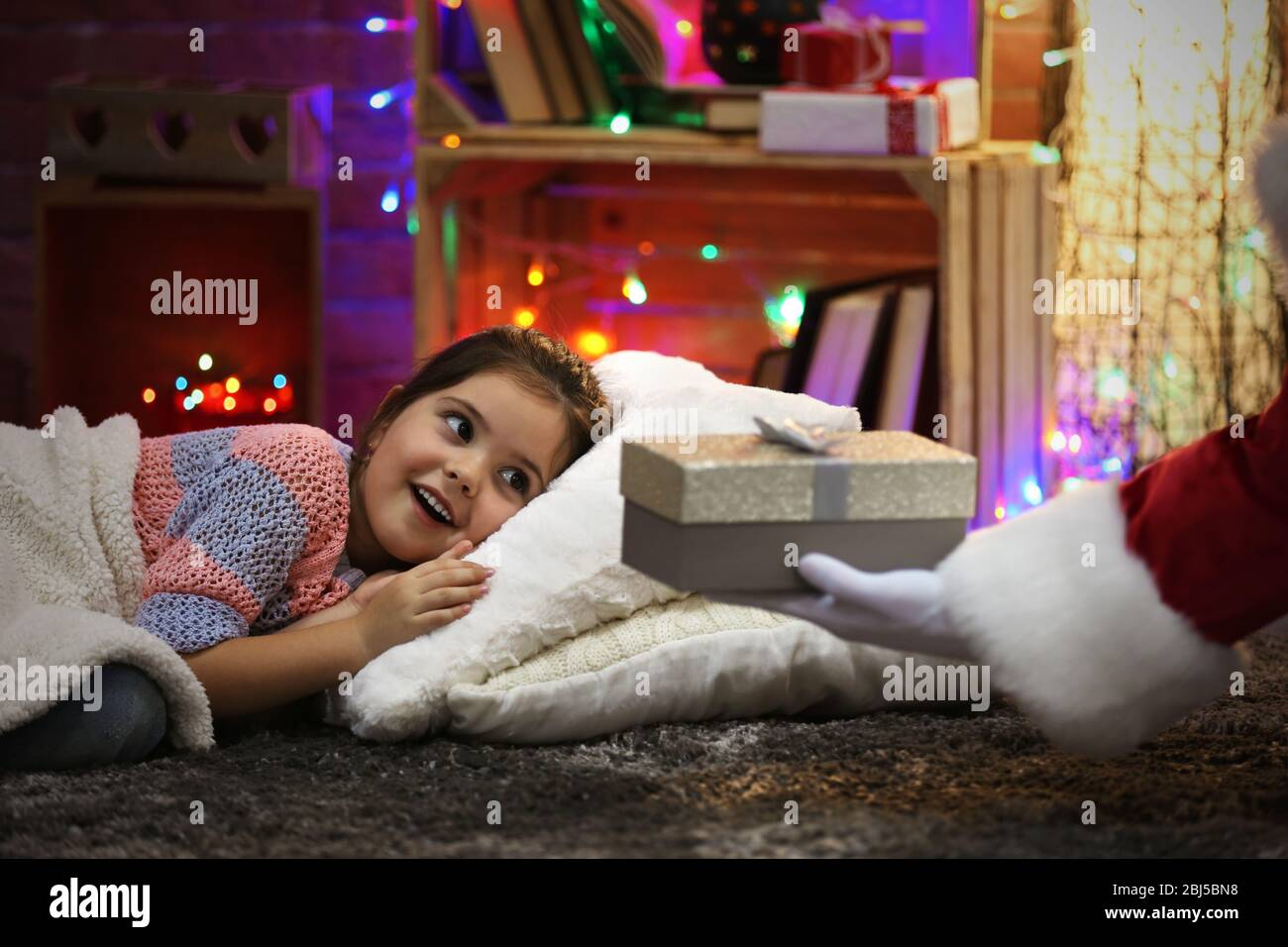 Pretty Little Girl Laying On The Pillow Under Soft Plaid Waiting For Santa S Gift In Christmas Decorated Room Stock Photo Alamy