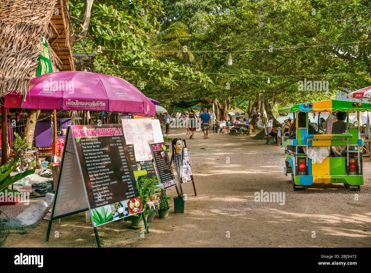 Busy Shopping Street and Thai Massage Parlor at Ao Nang Beach, Thailand Stock Photo