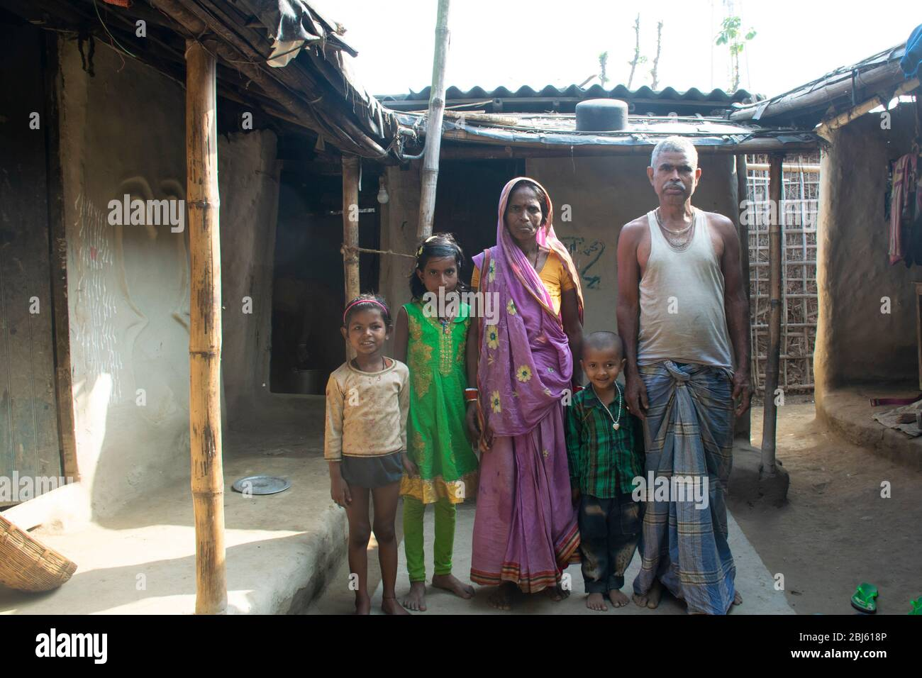 Poor Indian family in front of their house, Bihar, India Stock Photo