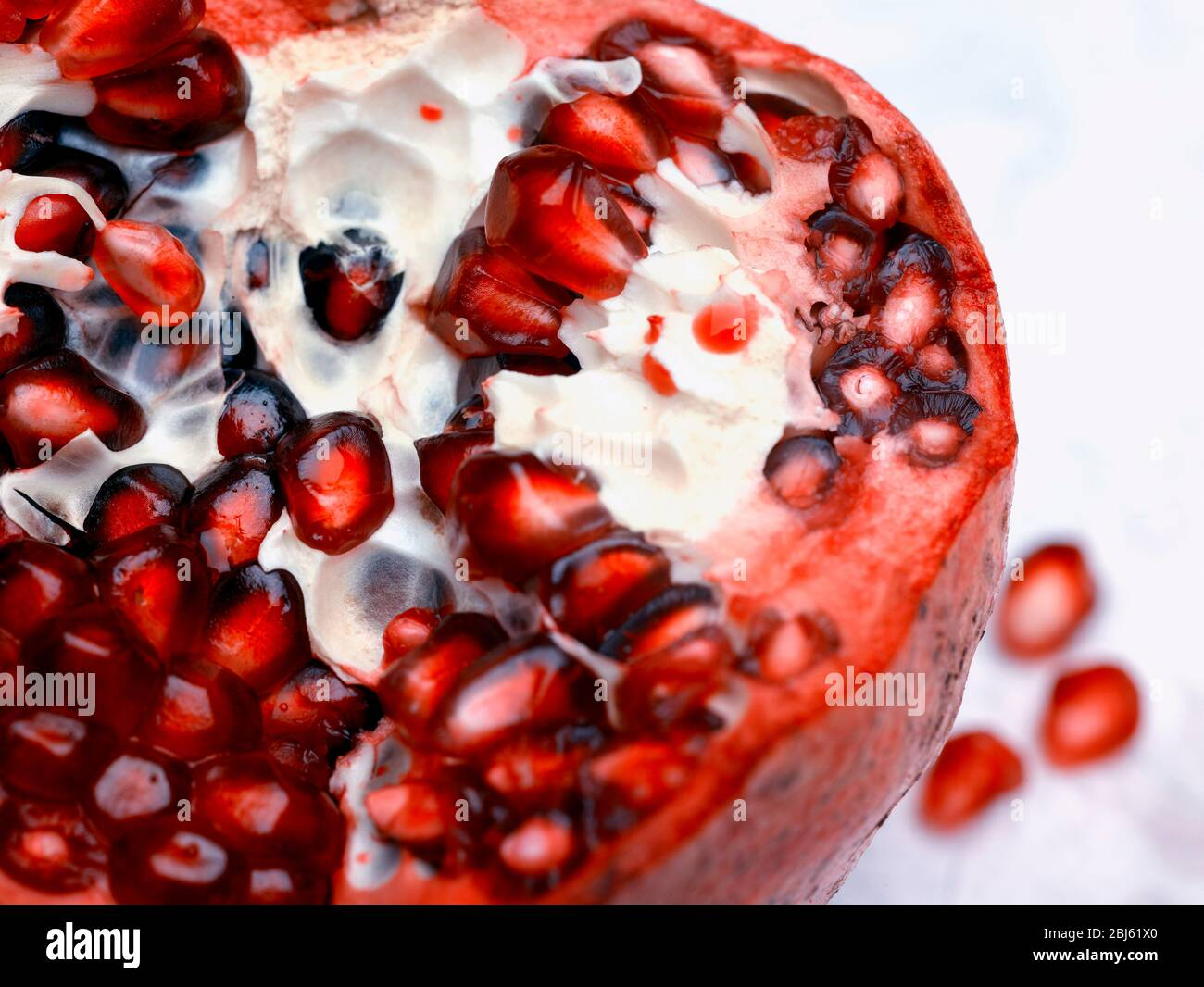 Still-life of Pomegranate and seeds depiction, natural fruit portrait Stock Photo