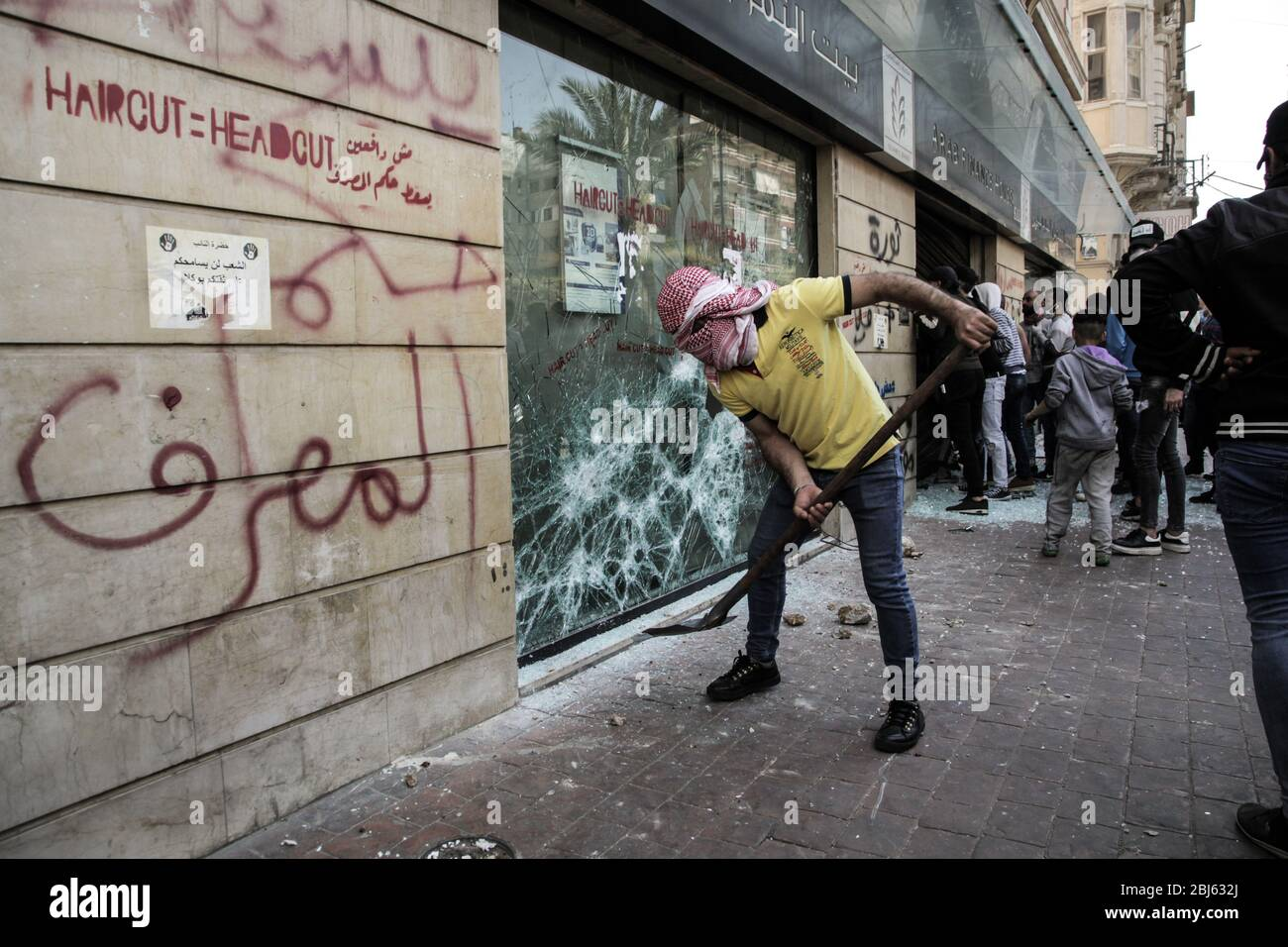 Tripoli, Lebanon, 28 April 2020. Protesters attack a branch of the Arabic Bank during riots that broke out following the death of a protestor shot by the army during protests triggered by economic collapse the previous night. Elizabeth Fitt Credit: Elizabeth Fitt/Alamy Live News Stock Photo
