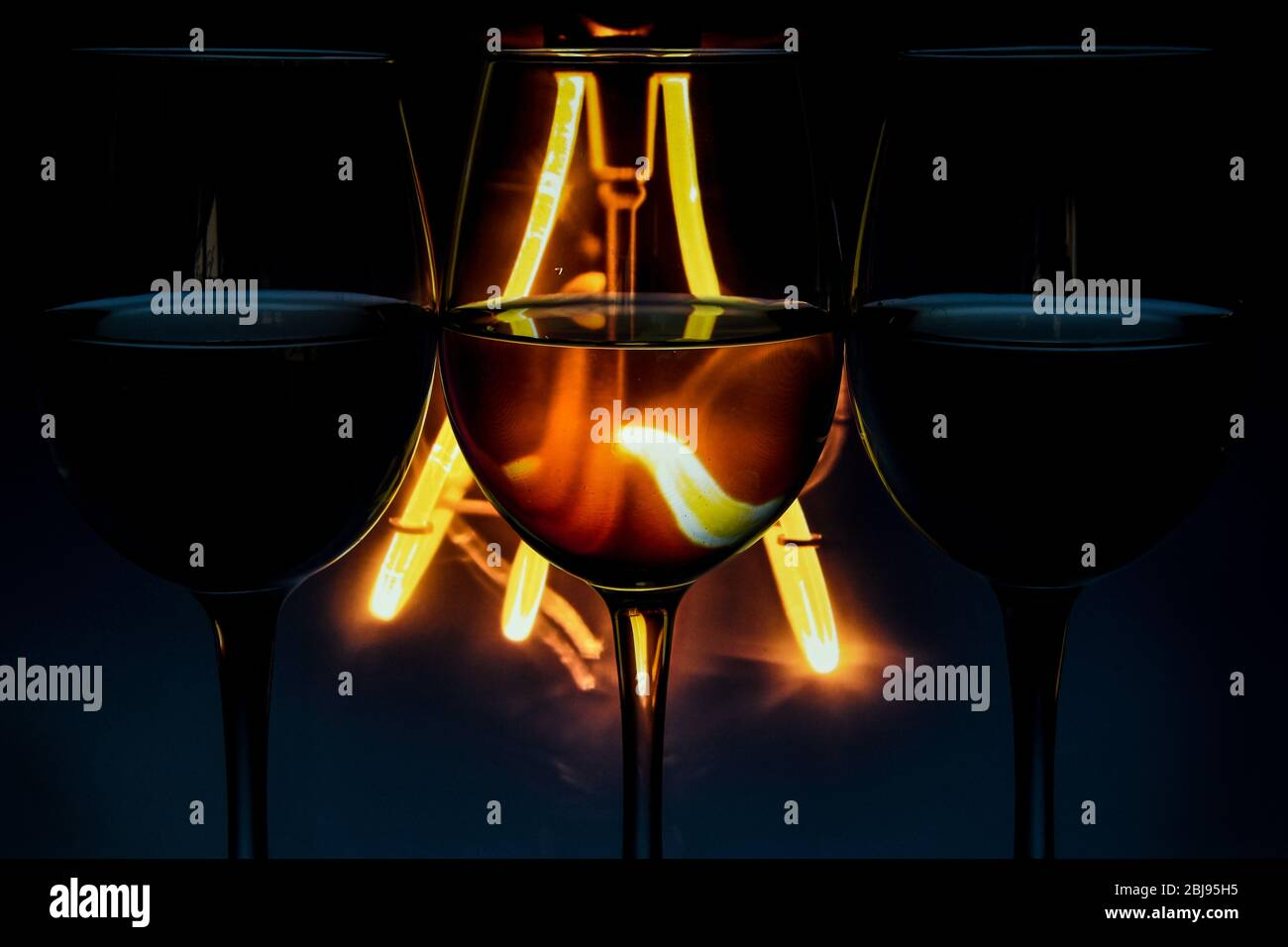 Three Wine Glasses In A Row With Dark Light Behind Set Of Three Wine Glasses With Red White And Rose Wine Banner Stock Photo 355473137 Alamy