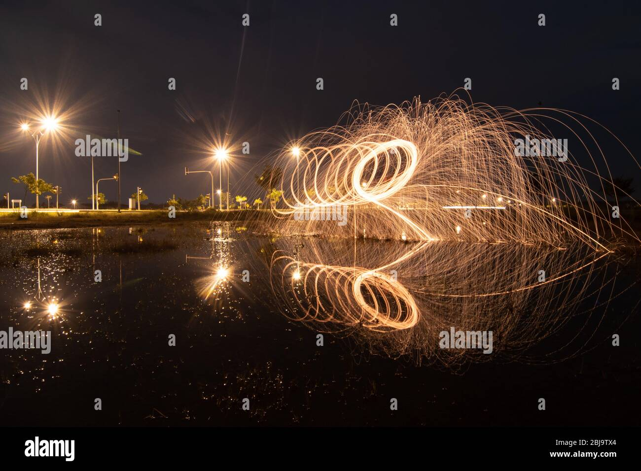 Fire steel wool with reflection. Stock Photo