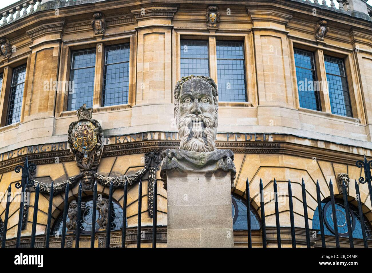 Philosopher's head outside Oxford's Sheldonian Theatre where graduations are held - this year, silent during the Coronavirus / Covid-19 lockdown Stock Photo