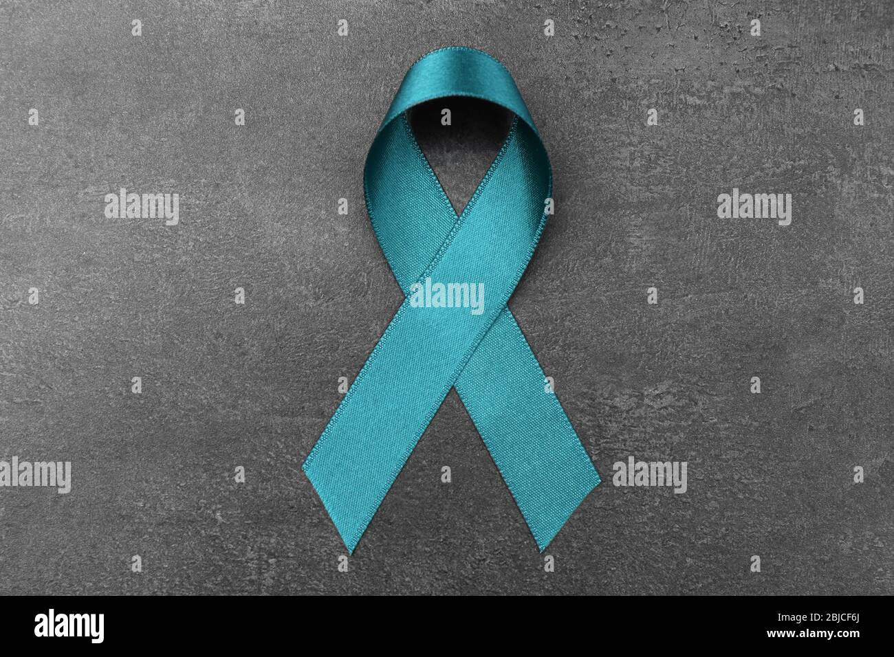 Sea Green Ribbon On Grey Background Ovarian Cancer And Gynecological Disorders Concept Stock Photo Alamy