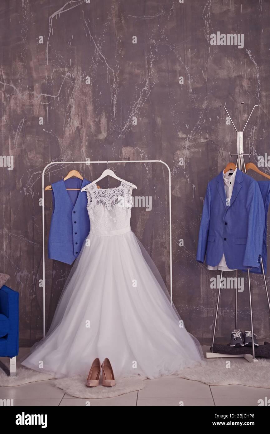 Bride Dress And Groom Suit In Dressing Room Indoors Stock Photo Alamy,Beach Flowy Sleeveless Beach Flowy Wedding Dresses