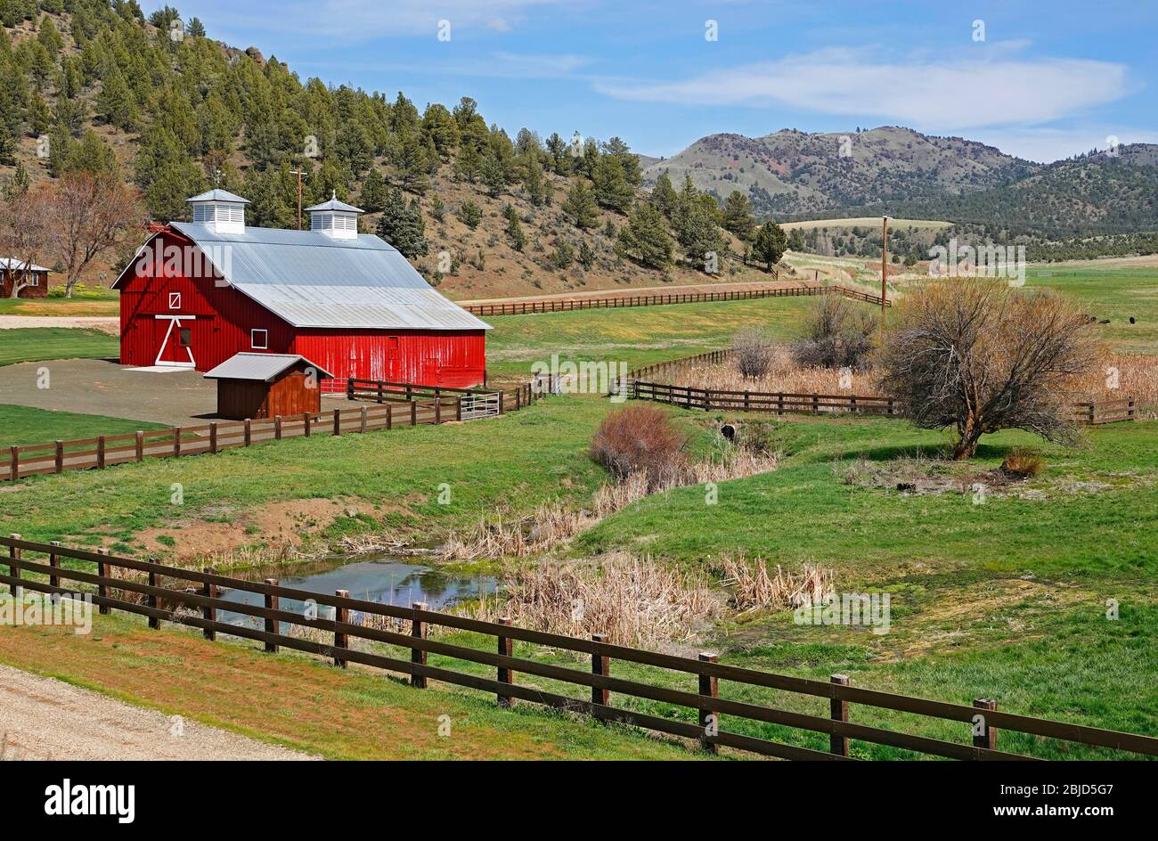 A beautiful red barn on a ranch near the John Day River in central Oregon. Stock Photo