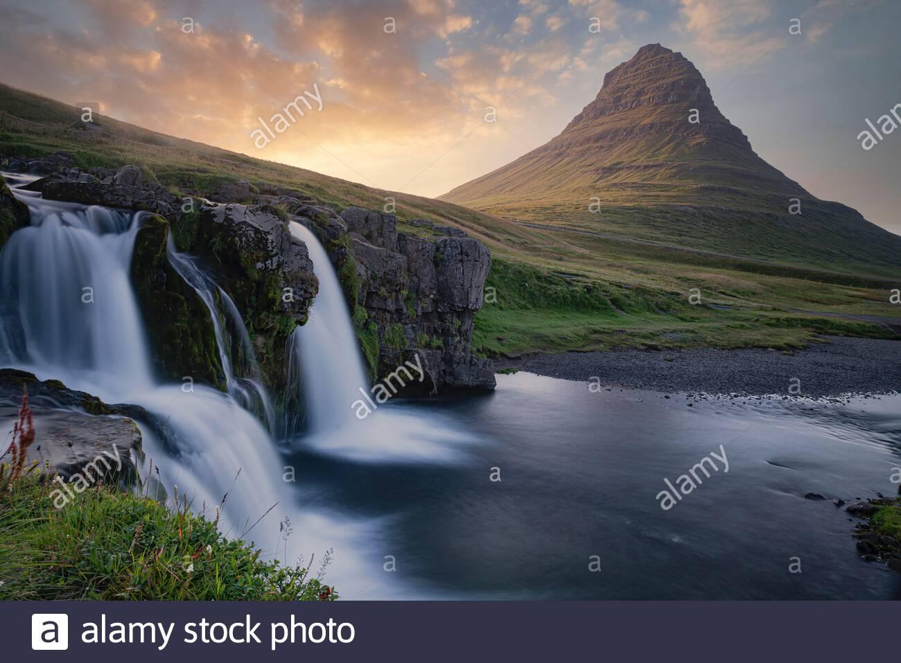 Iceland : Kirkjufell mountain and Kirkjufellfoss (falls) in Snæfellsnes peninsula, near the town of Grundarfjörður Stock Photo