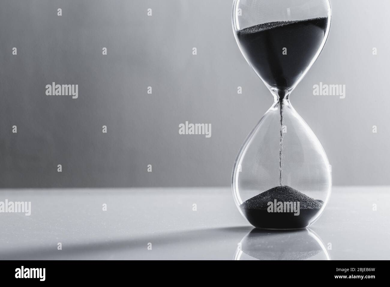 Close up hourglass on table. Close up. Stock Photo