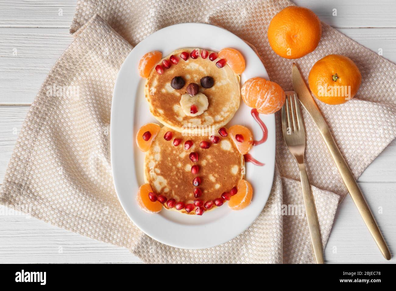 Funny pancakes for kids breakfast on wooden background Stock Photo
