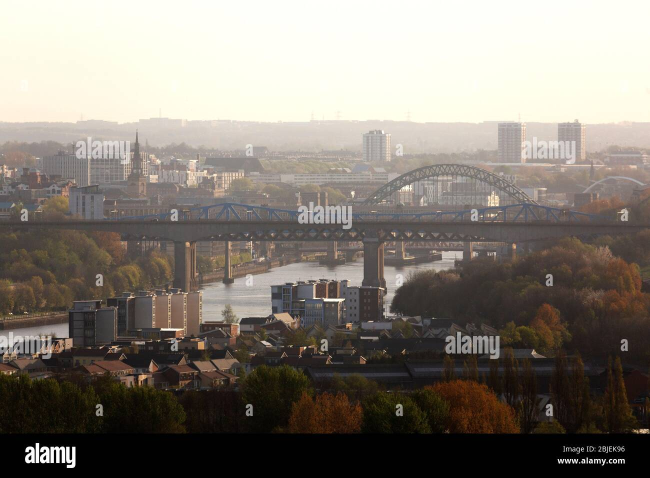 A hazy morning in Newcastle upon Tyne, England. The Redheugh Bridge spans the River Tyne between Newcastle and Gateshead. Stock Photo