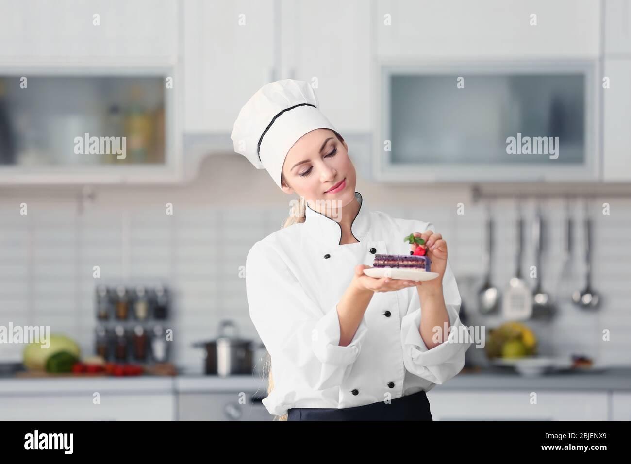 Female Chef Decorating Cake In Kitchen Stock Photo Alamy