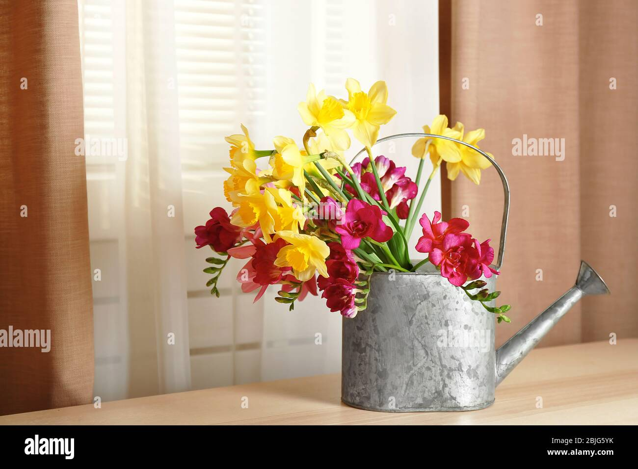 Vintage Watering Can With Beautiful Flowers On Table Stock Photo Alamy