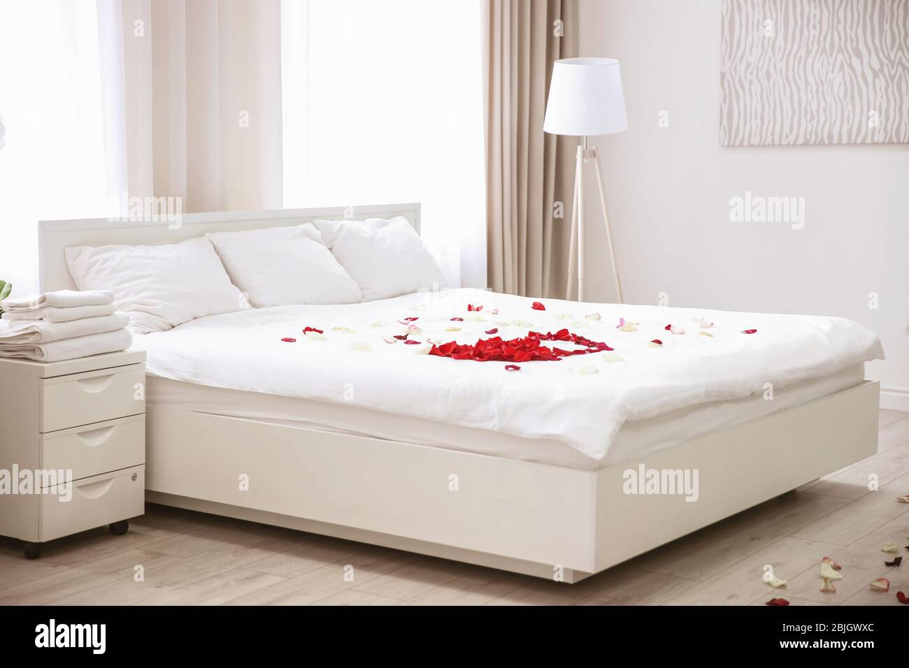 Rose Petals On Bed In Hotel Room Stock Photo Alamy