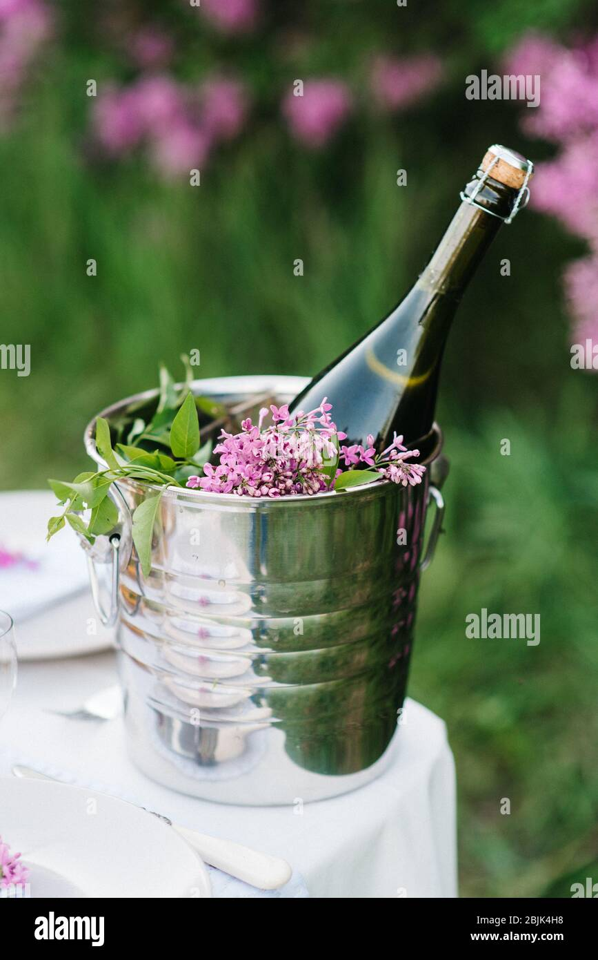 A Bottle Of Wedding Champagne In An Ice Bucket On A Table In The Garden Stock Photo Alamy