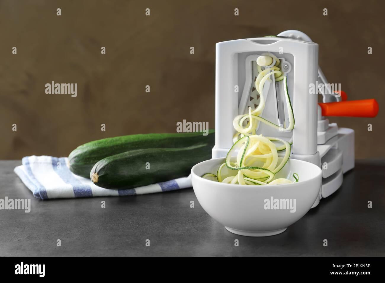 Making spaghetti squash on kitchen table Stock Photo