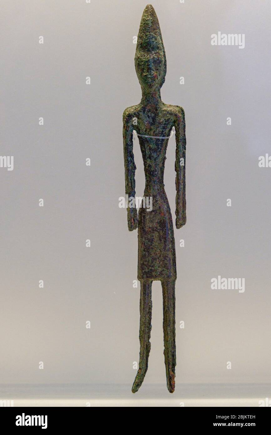 male statuettes, from Byblos, bronze, middle bronze Age, Beirut National Museum, The Coliseum , Rome, Lazio, Italy ,. Stock Photo