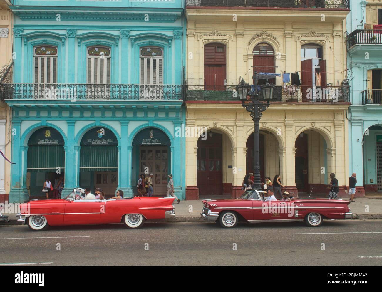 Vintage automobiles and crumbling colonial architecture, Havana, Cuba. Stock Photo
