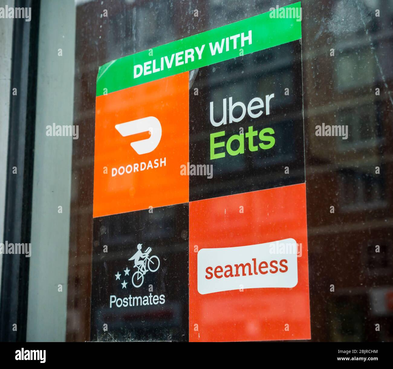 A restaurant in Chelsea in New York displays their cornucopia of delivery services on Tuesday, April 21, 2020.  (© Richard B. Levine) Stock Photo