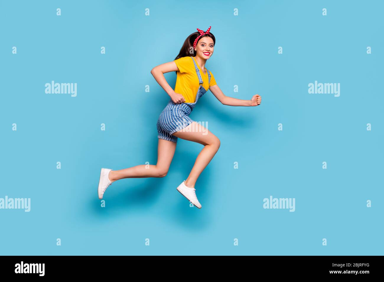 Full length body size view of her she nice attractive lovely cheerful cheery energetic girl jumping running fast isolated over bright vivid shine Stock Photo
