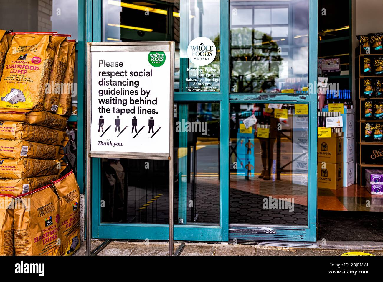 Reston, USA - April 27, 2020: Northern Virginia metro area Plaza America Whole Foods Amazon grocery store sign for social distancing at shop entrance Stock Photo