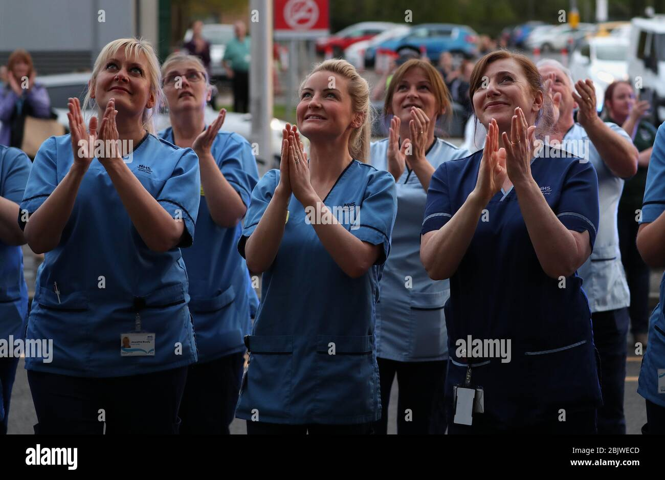 nursing-staff-clap-as-their-colleagues-look-out-from-a-window-at-the-queen-elizabeth-university-hospital-in-glasgow-as-they-join-in-the-applause-to-salute-local-heroes-during-thursdays-nationwide-clap-for-carers-to-recognise-and-support-nhs-workers-and-carers-fighting-the-coronavirus-pandemic-2BJWECD.jpg?profile=RESIZE_400x