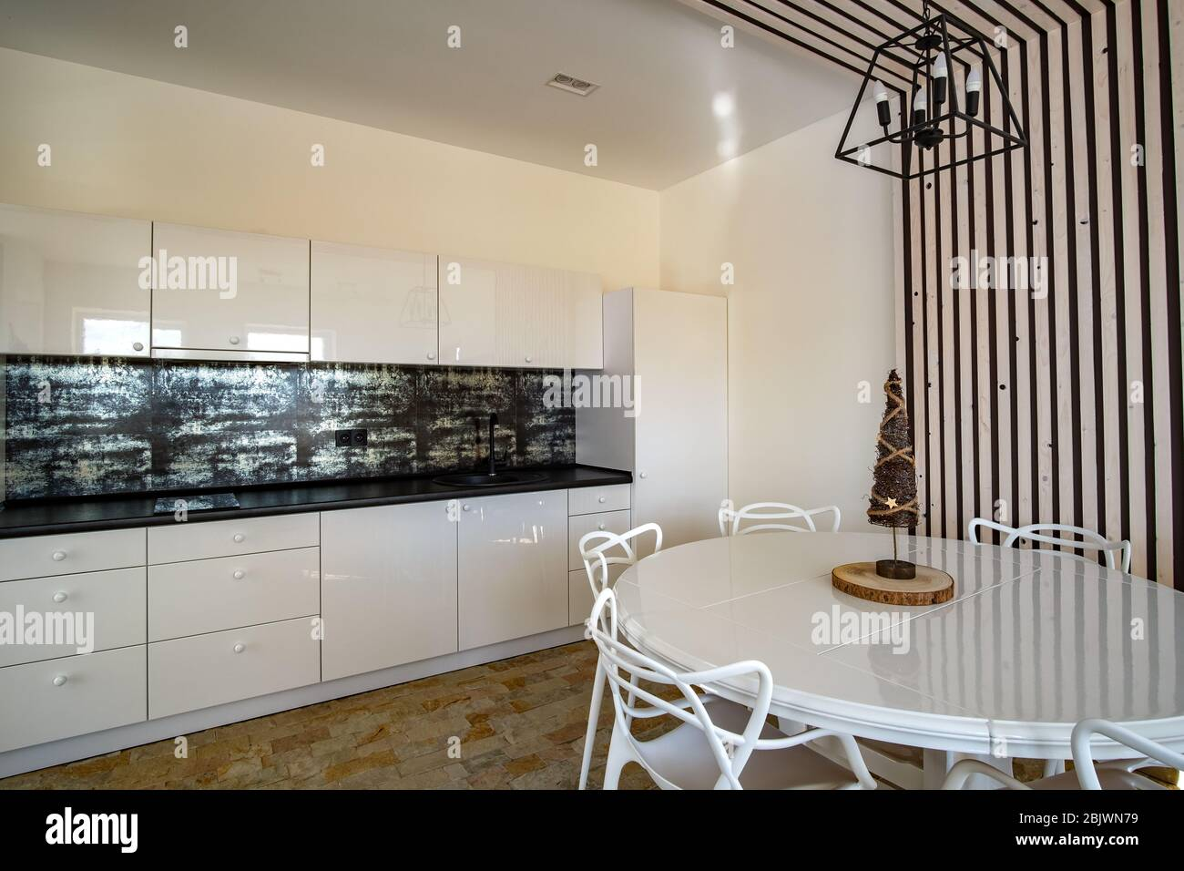 Interior Of Modern Spacious Kitchen With White Walls Decorative Wooden Elements Contemporary Furniture And Big Soft Couch Stock Photo Alamy