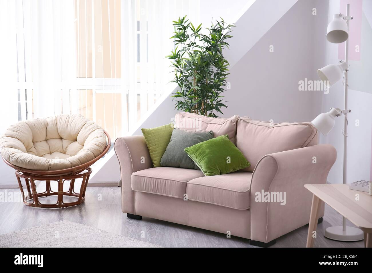 stylish living room interior with fortable sofa and lounge chair 2BJX5E4