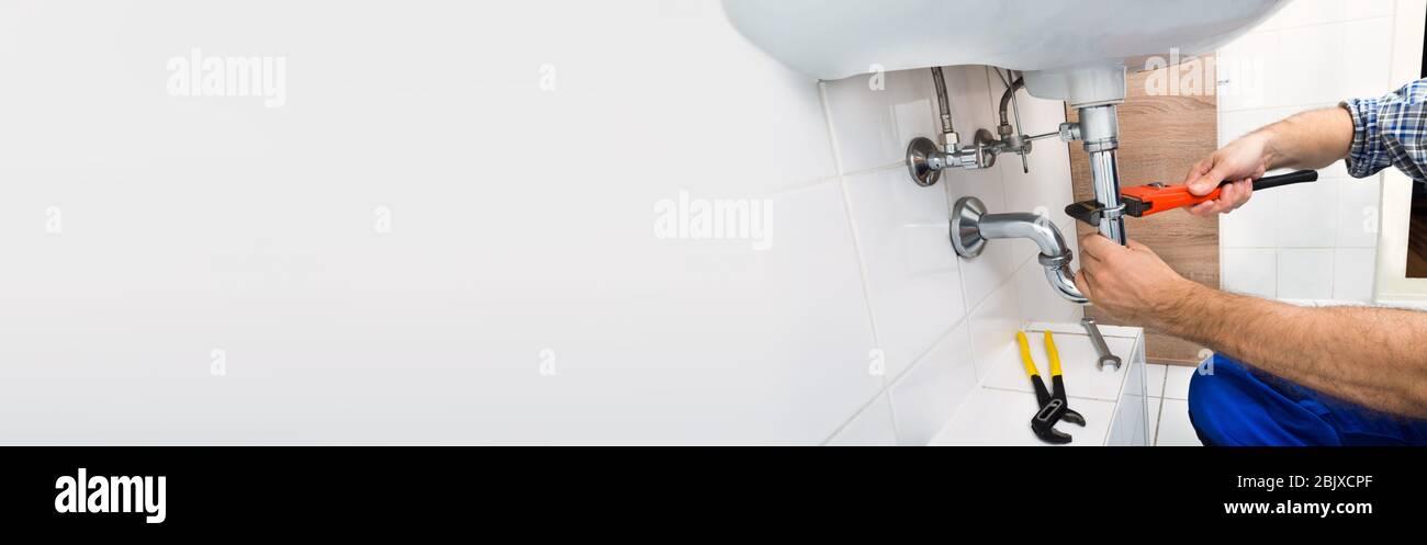 Plumber Plumbing Bathroom Sink And Doing Toilet Fix Service Stock Photo Alamy