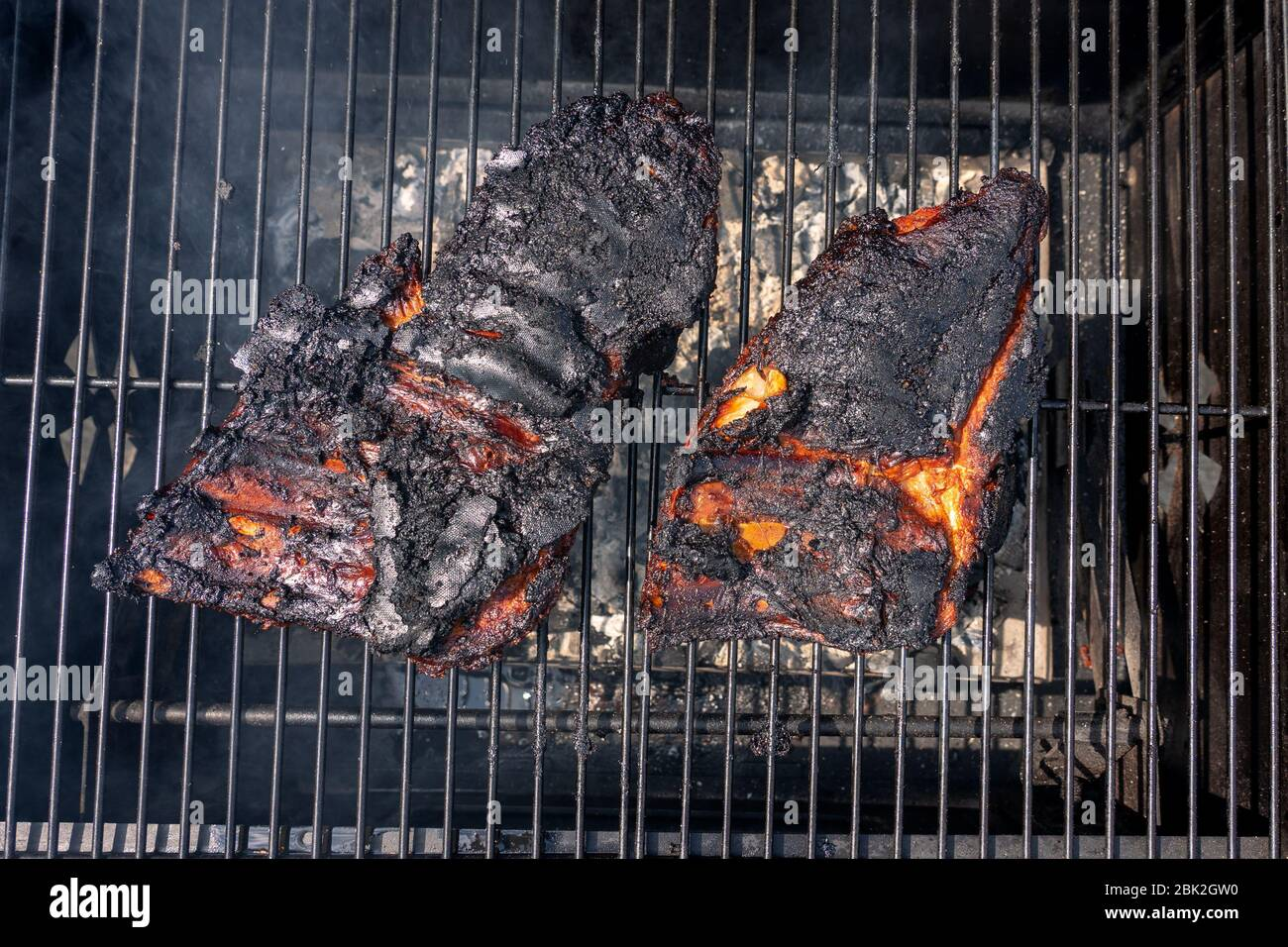 Overcooked Ruined Black Bbq Ribs On The Charcoal Grill Stock Photo Alamy