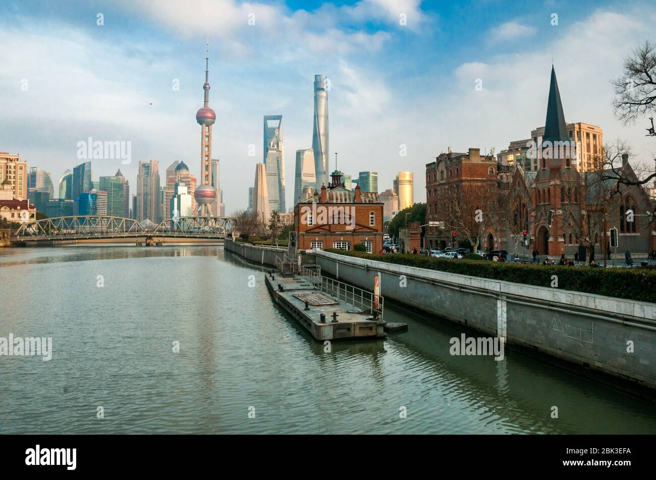 View along Suzhou Creek from the Zhapu Road bridge towards Garden Bridge and with the Pudong skyline in the background. Stock Photo