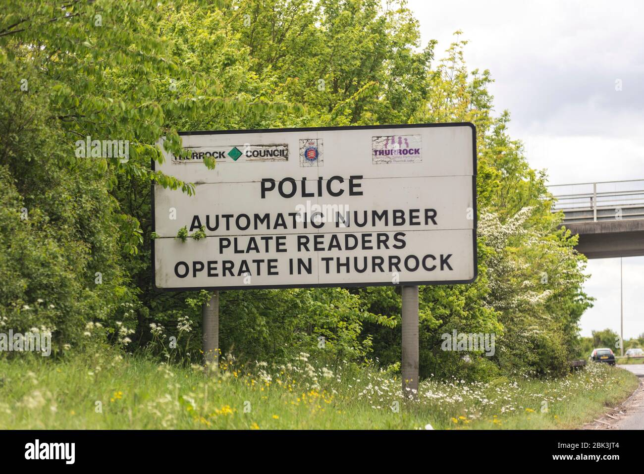 Police automatic number plate readers operate in Thurrock sign, Essex, UK. ANPR warning sign on A13 near Stanford le Hope. Number Plate Recognition Stock Photo