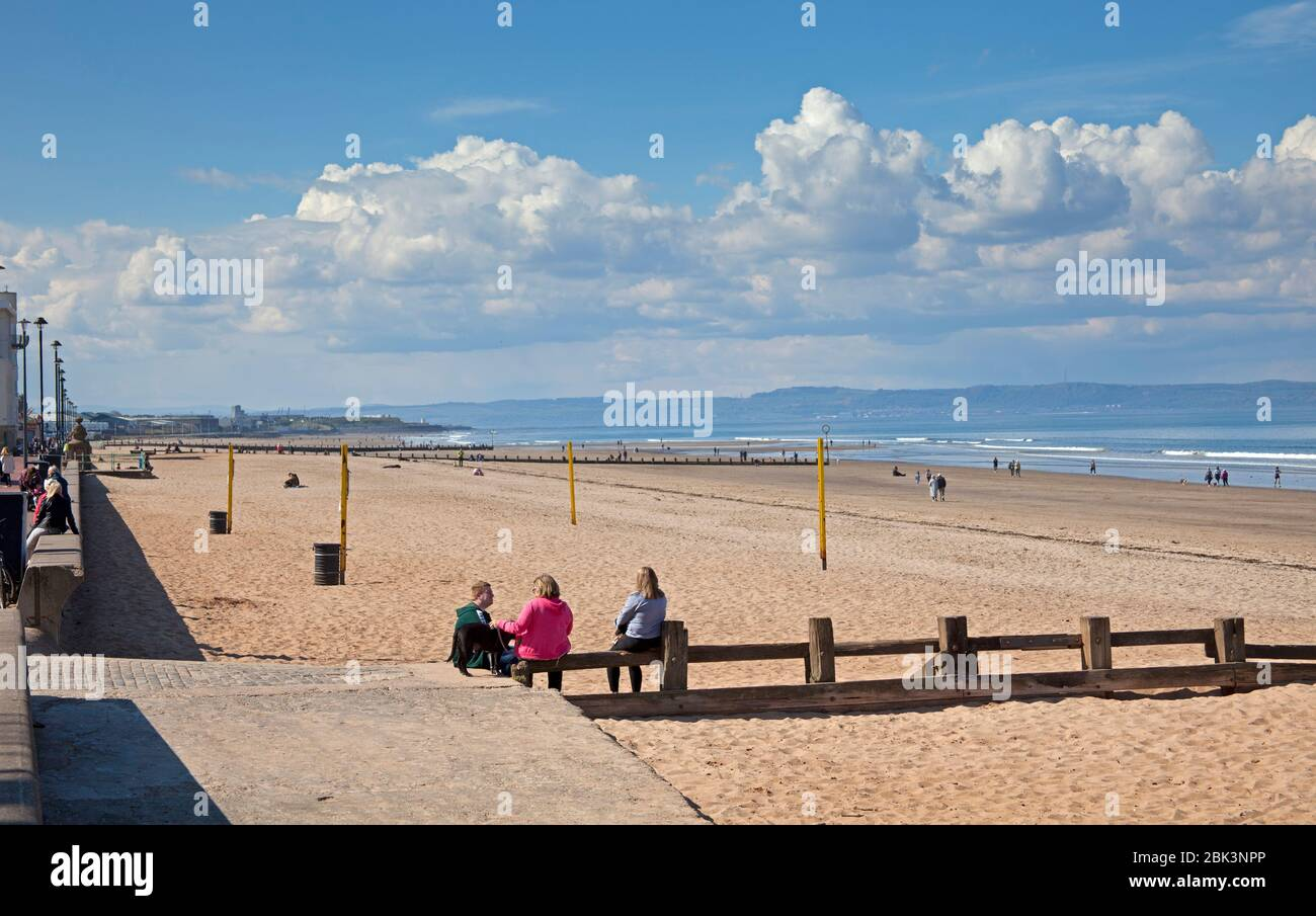 Portobello Beach, Edinburgh, Scotland, UK. 1st May 2020. Very quiet afternoon at the seaside on both the Promenade and the sandy beach. Unusual for such a sunny afternoon with temperature of 14 degrees centigrade. Perhaps people are still taking heed of the government warnings to stay at home due the Coronavirus Lockdown. Although there were many more vehicles on the High Street compared to previous  weeks. Credit: Arch White/Alamy Live News. Stock Photo