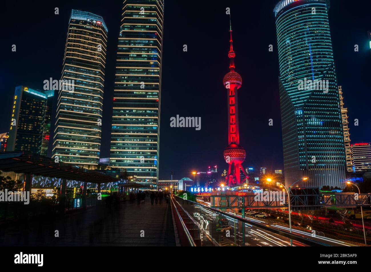 The Oriental Pearl Tower seen at night from the skywalk in Lujiazui in the Pudong New Area of Shanghai, China. Stock Photo