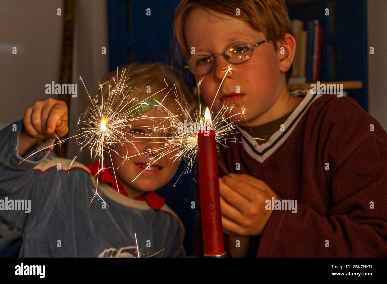 Two Brothers lighting sparklers in Grevenbroich, Germany Stock Photo