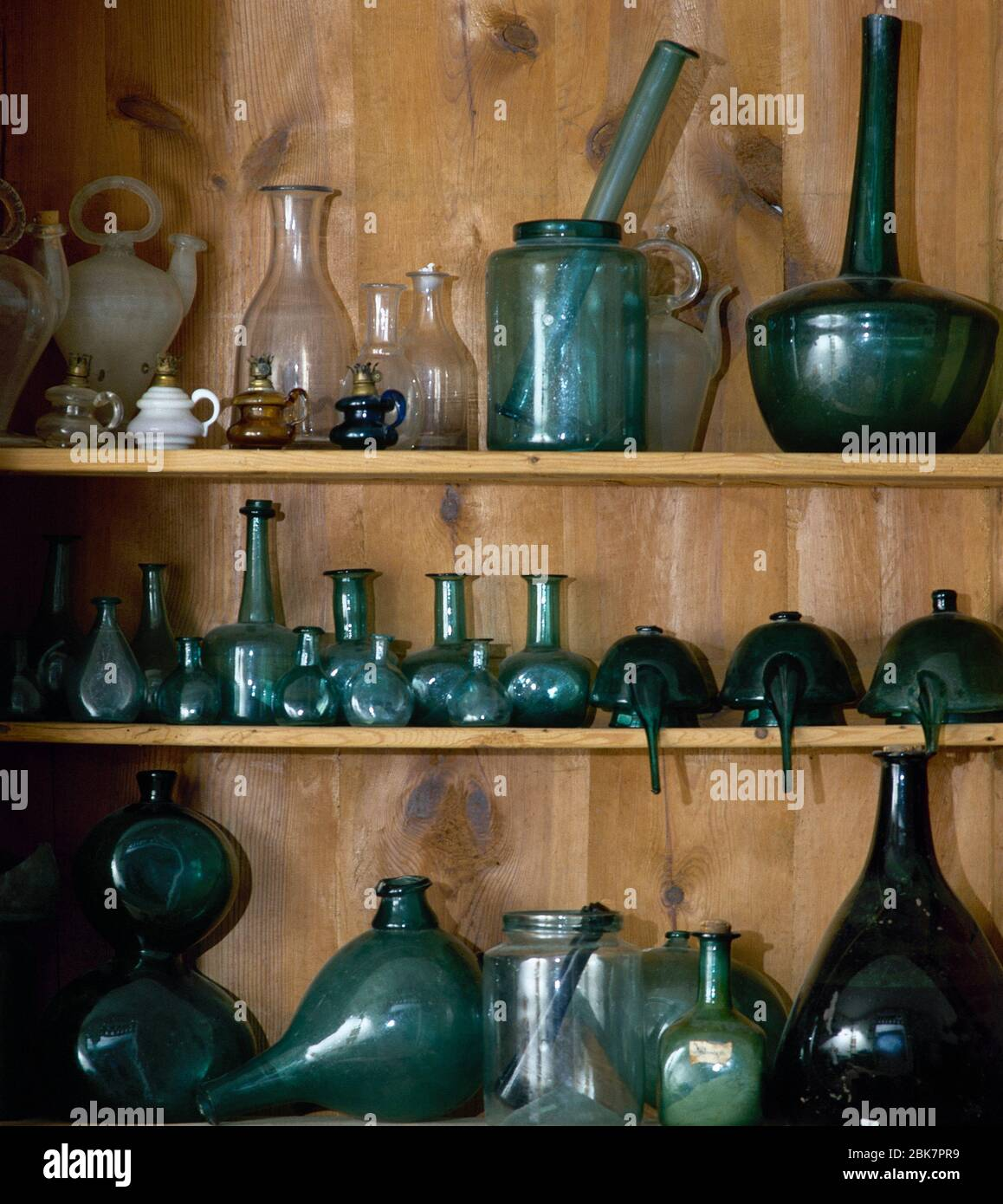 Apothecary (former pharmacy, 16-18th centuries). Glass containers. Royal Monastery of Santa Maria de Vallbona. Lleida province, Catalonia, Spain. Stock Photo