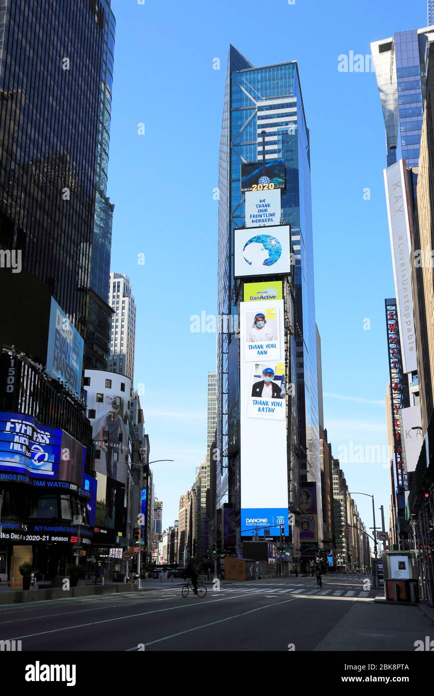 Billboards thanking essential workers in empty Times Square during coronavirus pandemic, New York City, May 1, 2020 Stock Photo