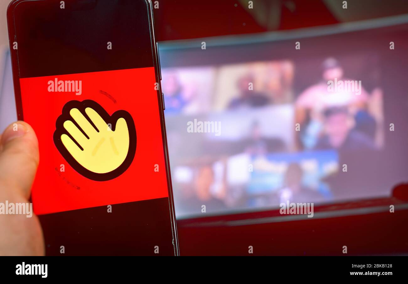 hand use videoconference app icon of Houseparty . Stock Photo