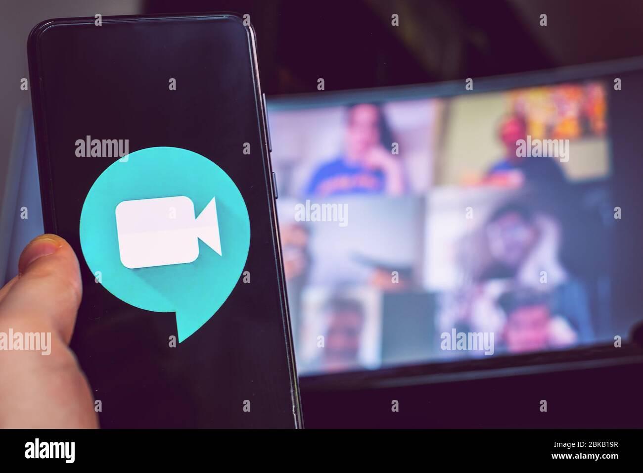 hand use videoconference app icon Goole Meet meeting  Stock Photo